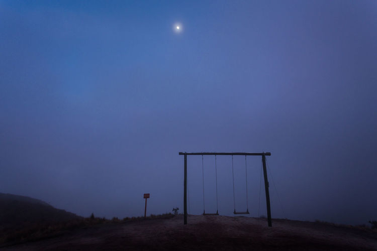 Swing on the teleferico, Ecuador Sky Moon Night Nature Tranquility Dusk No People Full Moon Tranquil Scene Fog Scenics - Nature Blue Beauty In Nature Outdoors Land Architecture Absence Landscape Moonlight Swing Tourist Attraction