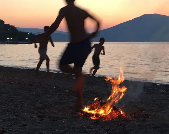 Beach Sommergefühle Summertime Jumping Over Fire Greek Traditions Sunset Boys Will Be Boys Sea And Sky Hills Neos Pyrgos, Evia An Eye For Travel This Is Masculinity Summer Exploratorium