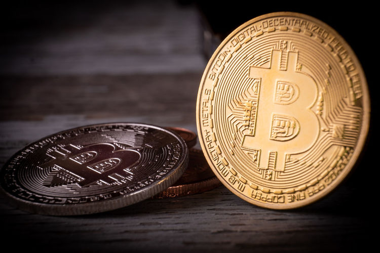 Bitcoin, virtual world payment system Business Economy Gold Golden Money Money Money Virtual Bitcoin Business Circle Close-up Coin Communication Currency Dollars Economy Euro Finance Focus On Foreground Gold Colored Indoors  Investment Metal Money No People Number Savings Still Life Table Text Wealth Western Script