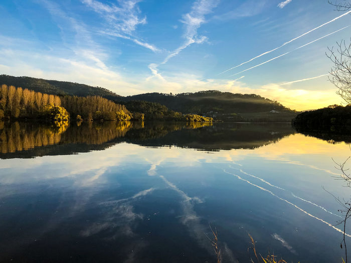 Getting the most of the day Reflection Sky Water Tranquility Tranquil Scene Lake Nature No People Scenics - Nature Beauty In Nature Ourense Galicia Laias River Miño Cloud - Sky Non-urban Scene Symmetry Blue Standing Water Reflection Lake Vapor Trail Springtime