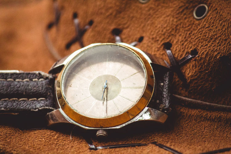 Close-up of wristwatch on leather hat