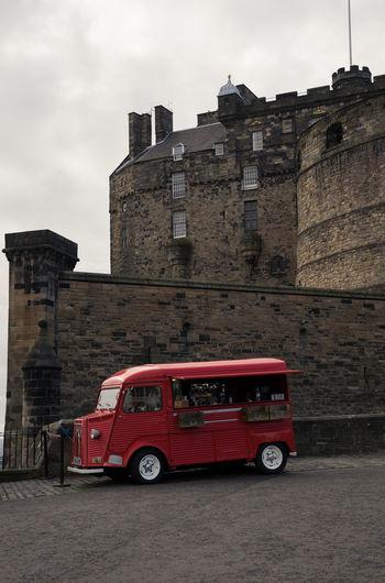 Red vintage car against sky