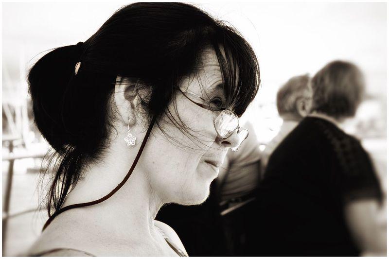 Side view of woman wearing eyeglasses