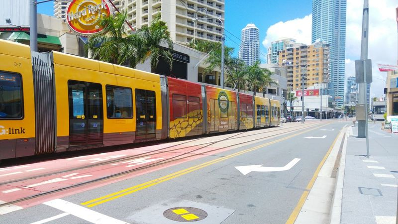 City Transportation Architecture Building Exterior Street Travel City Life Mode Of Transport City Street Built Structure Outdoors Land Vehicle Business Finance And Industry Yellow Public Transportation Travel Destinations Day Road Tram People City Surfers Paradise, Australia
