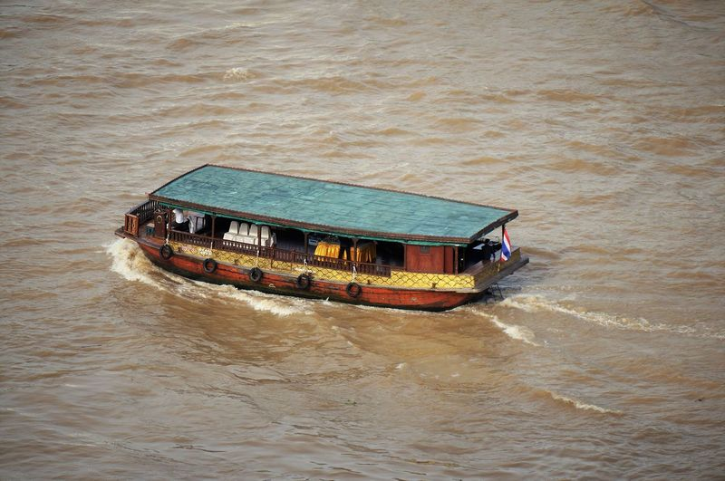 Chao Phaya River Thai Boxing  Wave Boat Boat Ride Day Floating On Water High Angle View Mode Of Transport Nature Nautical Vessel No People Outdoors River Sea Transportation Vintage Boat Water Waterfront EyeEmNewHere