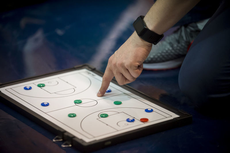 Low section of person playing game on floor