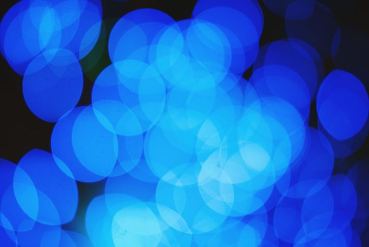 Blue Bokeh Blue Abstract Backgrounds Pattern Multi Colored No People Illuminated Defocused Night Close-up Outdoors Bokeh Photography Orbs Glowing Blue Tones Circles Shapes Shapes And Forms Light Shapes Defocus Neon Life