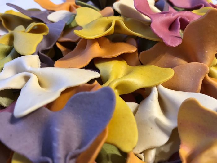 Abundance Coloured Pasta Colours Bows Pasta Backgrounds Full Frame No People Indoors  Close-up