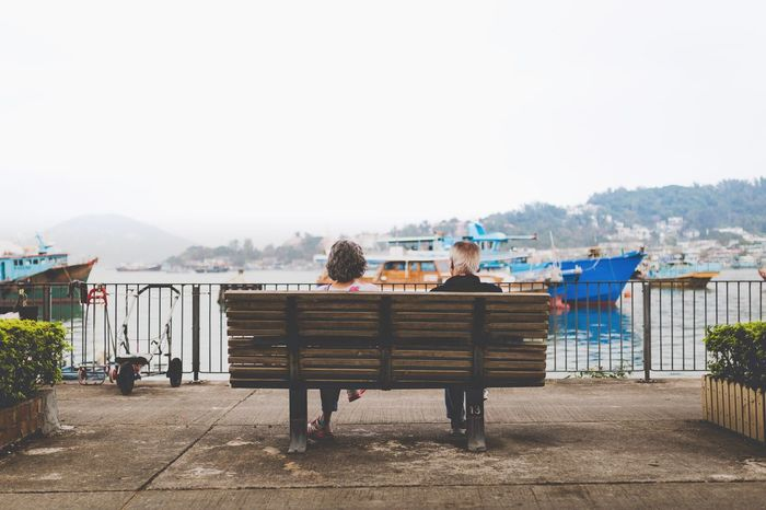 Bench Two People Sitting Full Length Togetherness Love Bonding Pier Leisure Activity Water Day People Adult Clear Sky Outdoors Females Sky Childhood Nature Real People White Hair Elderly Growing Old Together The Street Photographer - 2017 EyeEm Awards