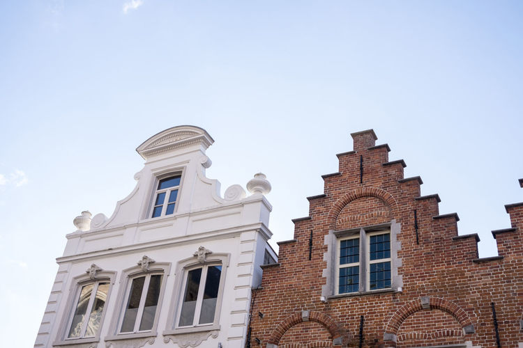 Bruges housefronts Low Angle View Sky Building Exterior Architecture Built Structure Window Building No People Nature Day Clear Sky Outdoors Blue The Past History Religion Bruges Brugge Belgium Townhouse Housefront Flemish Architecture Marketplace Architecture UNESCO World Heritage Site