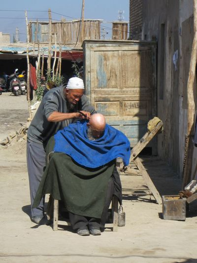 Urumqi Xinjiang Of CHINA China Men Outdoors Working Man Barber Life Barber Capture The Moment Unusual Find Gem Inspirational Bald Man Haircut Working Mans Hands People And Places People And Places. Snap a Stranger The Street Photographer - 2017 EyeEm Awards Connected By Travel An Eye For Travel The Street Photographer - 2018 EyeEm Awards