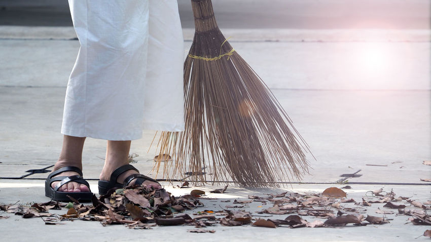 Old woman is sweeping dry leaf on the outdoor cement floor by big long broom. Cleaning Adult Adults Only Blooming Broom, Wooden, Closeup, Swab, Manual, Floor, Dust, Parquet, Housework, Tidying, Dusty, People, Living, Household, Worker, Female, Tidy, Girl, Swabber, Woman, Housecleaning, Sweeping, Professional, Home, Servant, Work, Indoors, Janitor, Maid, Concept, Clea Day Floor Low Section Old Woman One Person One Woman Only People Sweeping; Floor; Broom; Sweep; Brush; Cleaning; Home; Housework; Wooden; Dustpan; Cleanup; Household; Woman; Dust; Dirt; Cleaner; Maid; Closeup; Work; Dirty; Clean; Housekeeping; Tidy; House; Tool; Garden; Person; Brooming; Girl; Garbage; Human; People; S