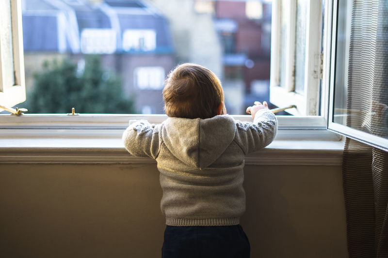Blonde Home Victorian Childhood Day Daylight Hoddie Indoors  Lifestyles Looking Through Window One Person Real People Rear View Standing Toddler  Toddler Boy Toddlerlife Window Windows