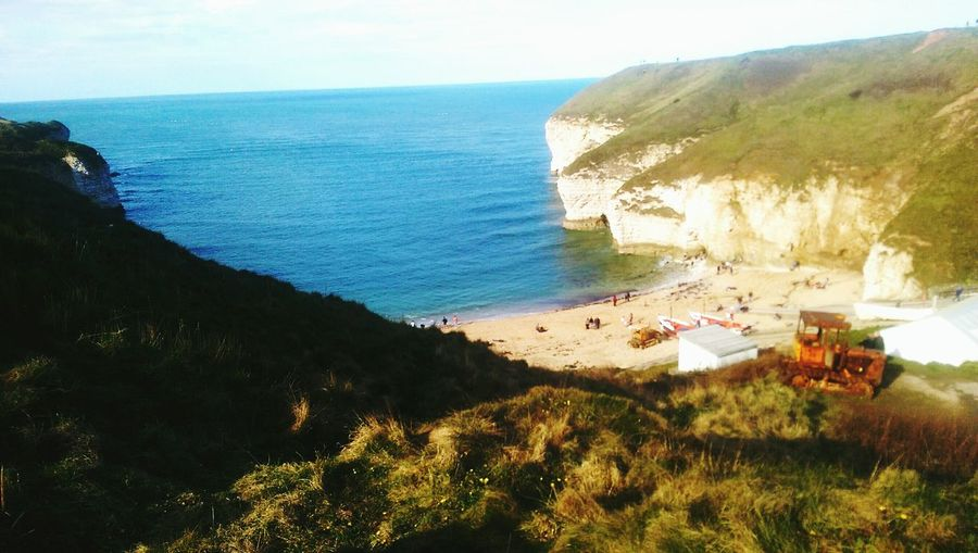 Sea Beach Sand Cliffs Tractor View Natural Landscape Hilltop Flamborough Head Northyorkshire Hidden Beauty Adventure Sea View Englishbeaches Sea And Sky Natural Beauty People Whitecliffs Activities Htc One M8