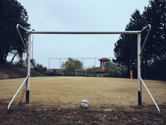 Soccer ball and goal post on playground
