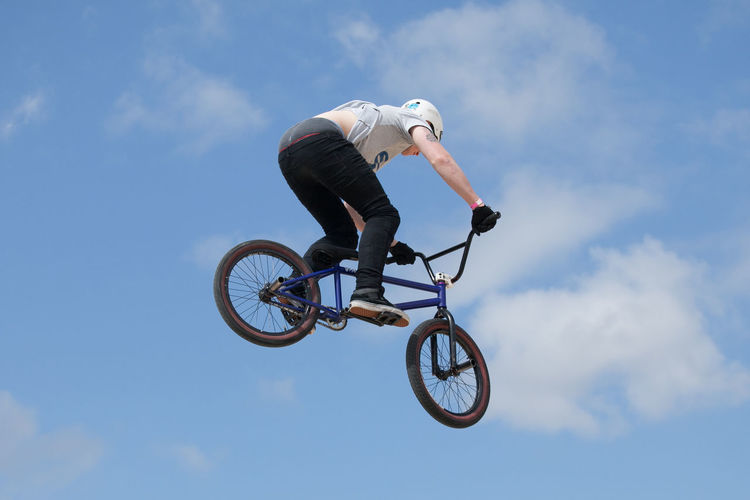 BMX stunt riders Adventure Bicycle Blue Bmx  BMX Contest Bmxlife Courage Danger Enjoyment Exhilaration Extreme Sports Helmet Leisure Activity Lifestyles Mid-air Mode Of Transport Motion RISK Sky Sport Stunt Vitality