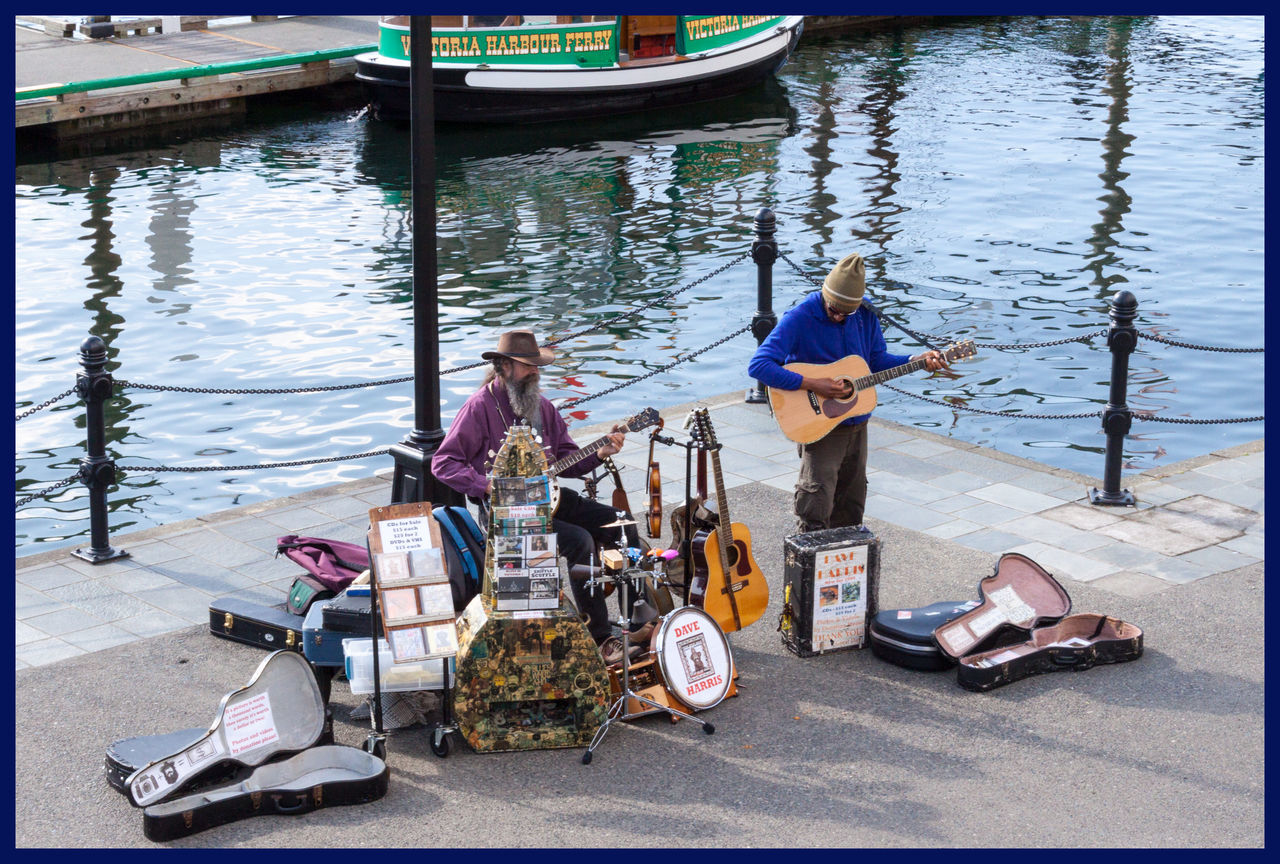 water, sitting, real people, transportation, full length, day, high angle view, men, women, outdoors, holding, nautical vessel, standing, guitar, musical instrument, young adult, musician, young women, nature, adult, adults only, people
