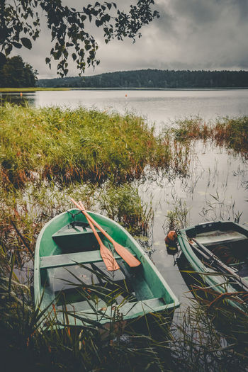 Beach Beauty In Nature Day Lake Mode Of Transportation Moored Nature Nautical Vessel No People Outdoors Plant Reflection Rowboat Scenics - Nature Sky Tranquil Scene Tranquility Transportation Tree Water