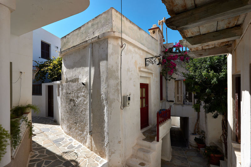 Naxos Town Alley Architecture Building Building Exterior Built Structure Courtyard  Day Door Entrance Flower Flowering Plant House Nature No People Old Outdoors Plant Potted Plant Residential District Sunlight White Color Window