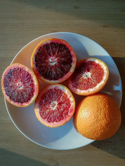 Red oranges fruits Oranges Calabrian Oranges Freshness Fresh Fruits Bio Fruits Biological Food Fruit Citrus Fruit Healthy Eating Cross Section Freshness Grapefruit Orange - Fruit Blood Orange Food Food And Drink SLICE No People High Angle View Indoors  Table Day Close-up