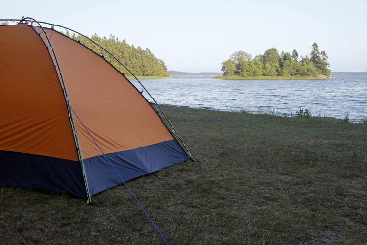 Tent on beach against sky