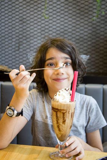 Girl having dessert at cafe