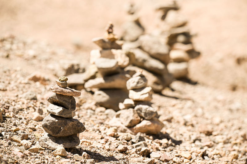 Close-up of stone stack on sand