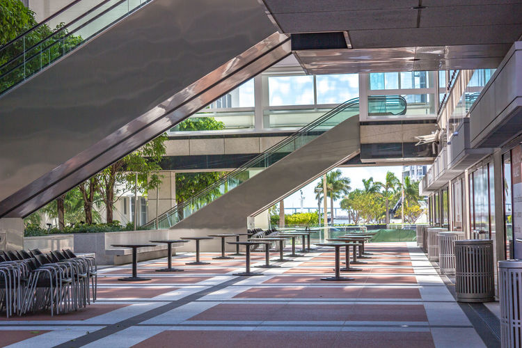Empty open-air cafeteria at noon. Miami, Florida Lines Angles And Lines Architecture Bridge - Man Made Structure Built Structure Circles City Day Empty Open-air Cafeteria No People Open To Outside Patio Railings Rectangles Sky Squares The Architect - 2017 EyeEm Awards Tiled Floor Trees Vegetation View To Outside Views
