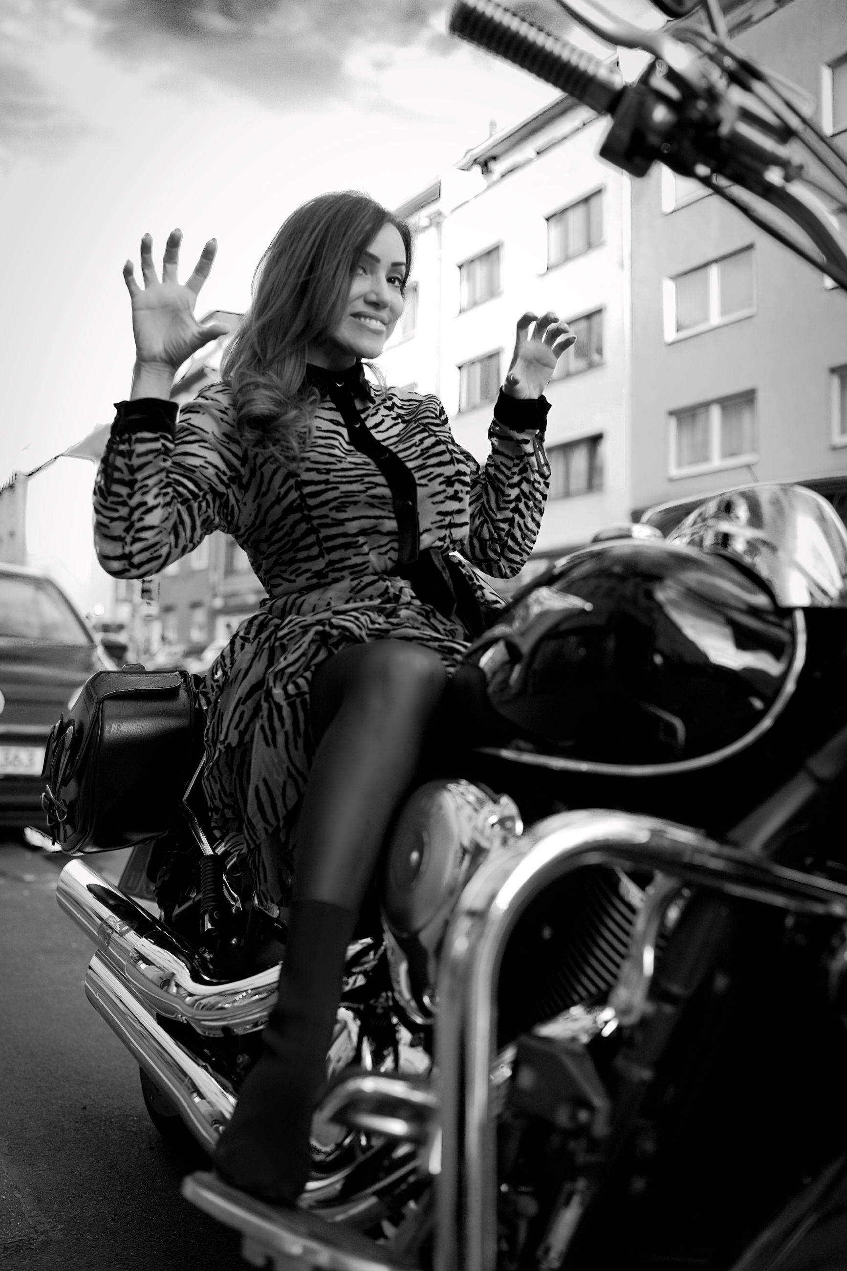 adult, transportation, women, mode of transportation, one person, black and white, motorcycle, black, architecture, fashion, city, young adult, monochrome, female, lifestyles, monochrome photography, vehicle, sky, travel, sitting, casual clothing, clothing, built structure, land vehicle, leisure activity, full length, activity, street, building exterior, city life, long hair, motor vehicle, nature, outdoors, emotion, car, person, hairstyle