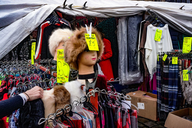 Market day at Skipton in Yorkshire. Skipton Yorkshire Adult Clothing Coathanger Day For Sale Hanging Hats Large Group Of Objects Market Market Stall One Person Outdoors People Retail