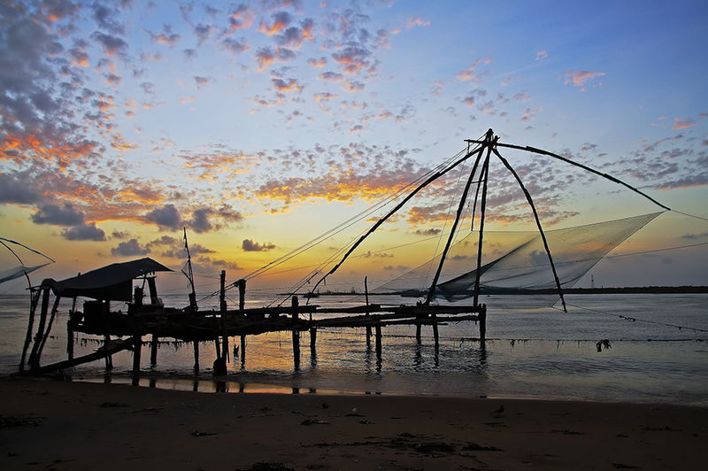 Chinese Fishing Nets at Fort Cochin Atmosphere Atmospheric Mood Beach Beautiful Chinese Fishing Nets Cloud Cloud - Sky Cochin Dusk Environmental Conservation Fishing India Kerala Kochi Nature Outdoors Sea Silhouette Sky Sunset Tourism Tranquil Scene Tranquility Travel Travel Destinations