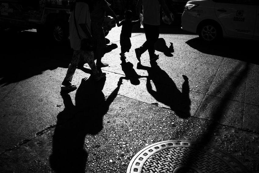 Fujifilm X-E2 + XF18mm. Dec 2015. Osmeña corner JR Borja St., CDO. B&w Street Photography Eyeem Philippines Light And Shadow Monochrome Shadows Street Photography Showcase: December