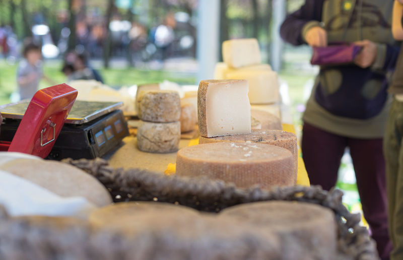 Various cheese for sale at market