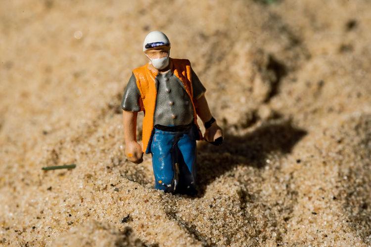 Full length of a man walking on dirt road