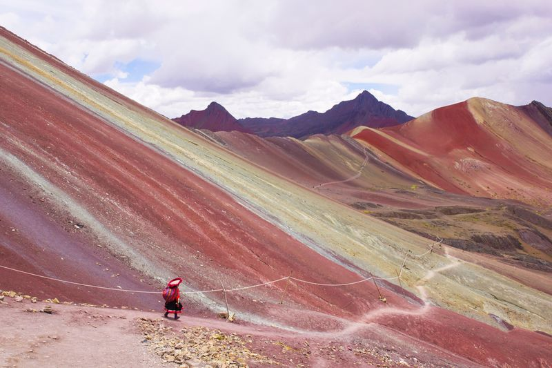 Rainbow mountain, Vinicunca-Cusco,Peru Vinicunca Rainbowmountains Cusco Peru Travel Sightseeing Andes Highlands Colorful Nature Cloud - Sky Landscape Mountain Sky Environment Beauty In Nature Nature One Person Mountain Range Red Outdoors Lifestyles