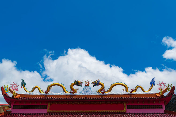 Statue Blue Copy Space Blue Sky Freshness Outdoors Colorful Colors Day Mythology City Dragon Chinese Dragon Roof Multi Colored Sculpture Cultures Sky Architecture City Gate Traditional Building Representing Neo-classical Decorative Art High Section Eaves Ornate Triumphal Arch Carp Roof Tile