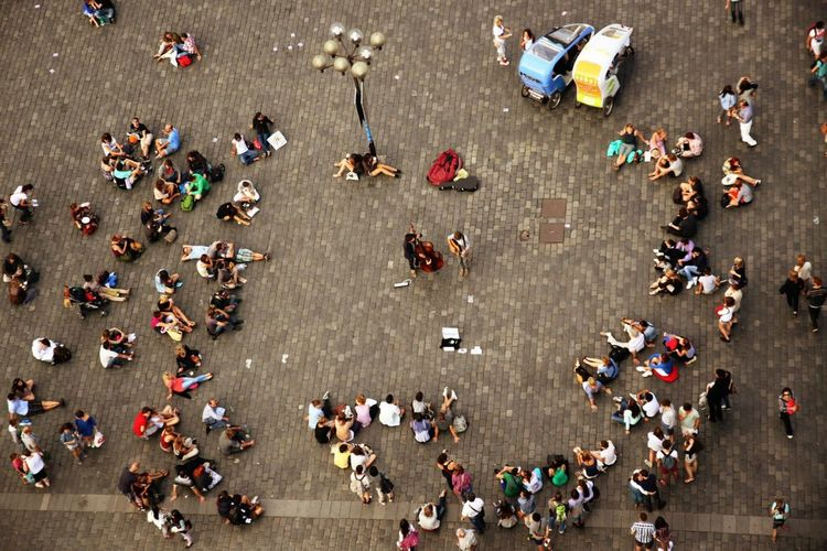 High angle view of people enjoying music at city square
