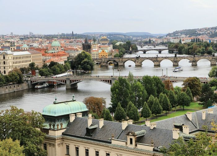 Vltava Tree Cityscape Water Roof City High Angle View Sky Architecture Building Exterior Built Structure TOWNSCAPE Housing Settlement Tiled Roof  Residential Structure Townhouse Old Town Rooftop Arch Bridge Row House Exterior Building Town Human Settlement #urbanana: The Urban Playground
