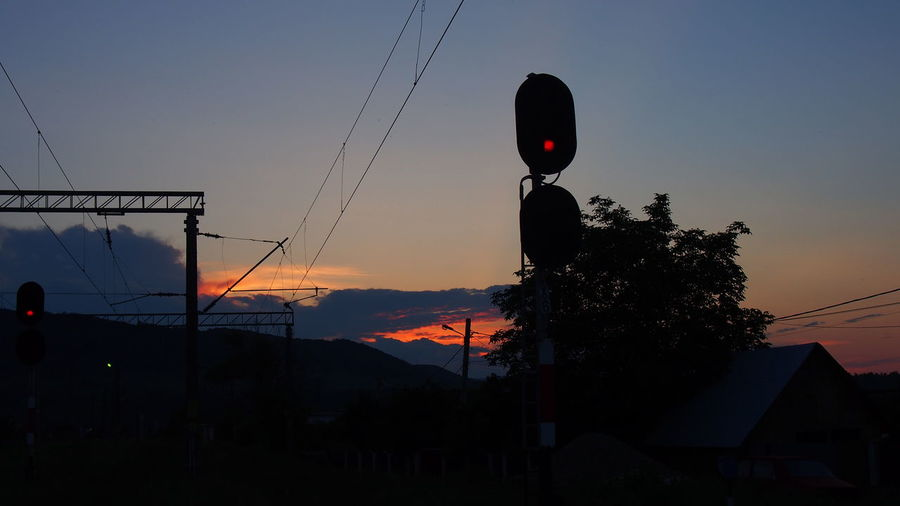 Built Structure Cable Orange Color Outdoors Pole Power Line  Sky Street Light Sunset Clouds And Sky Clouds Train Tracks Traintracks