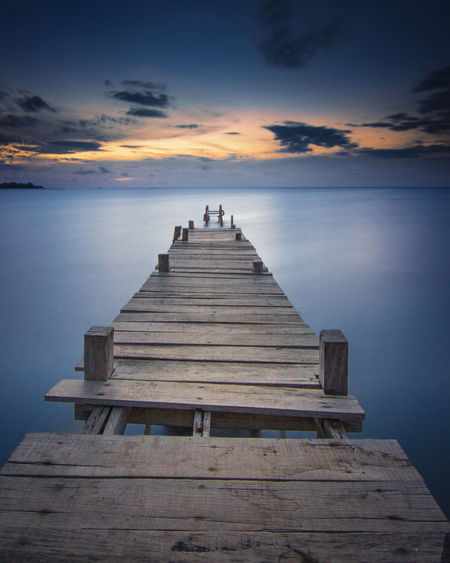 The Broken Bridge Sky Water Wood - Material Sea Pier Scenics - Nature Tranquility Nature Horizon Over Water No People The Way Forward Outdoors Wood Paneling Sunset Beauty In Nature Cloud - Sky Direction Bridge - Man Made Structure Bridge Tranquil Scene Idyllic Horizon Absence Long