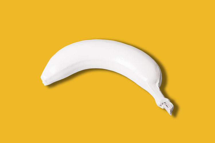 top view of white colored banana isolated on yellow background Banana White Isolated Yellow Color Background View Top Colored Abstract Fresh Healthy Natural Food Fruit Ripe Delicious Snack Dessert Nutrition Freshness Diet Concept Vitamin Gourmet Organic Plant Tropical Creative Whole Nature Art Nutritious Layout Design Breeding Macro Style Peel Skin Sweet Pattern Bright Lay Vegetarian Tasty Above Raw Single Idea
