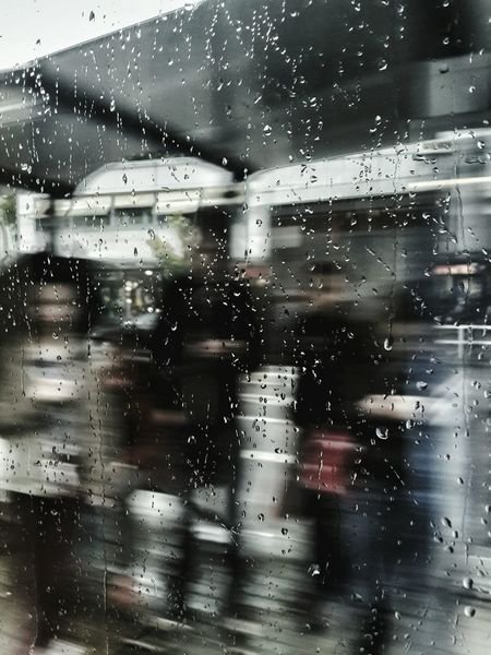 Waiting for the tram under the rain. Showing Imperfection Smartphones Addicts Tram Station  Tram Rain Raindrops People People Photography Street Photography Modern Smart Phones  Hooked Society Society Blurred Smartphone Photography Beautiful Mistakes Through The Rain