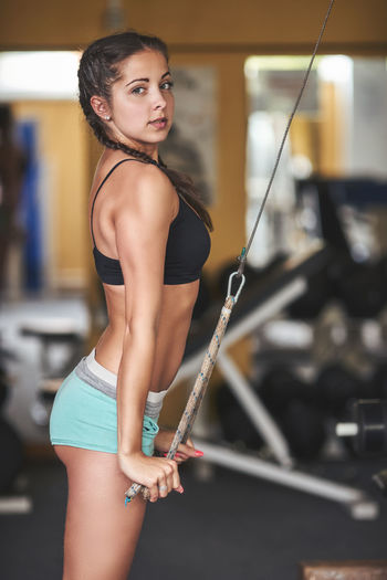 Portrait Of Woman Exercising With Pilates Machine In Gym