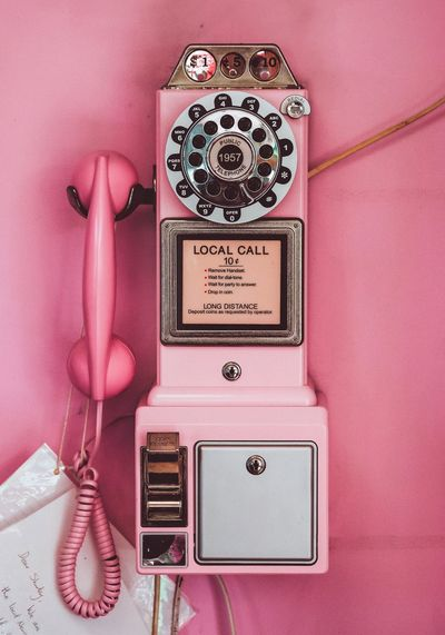 Text on pink pay phone