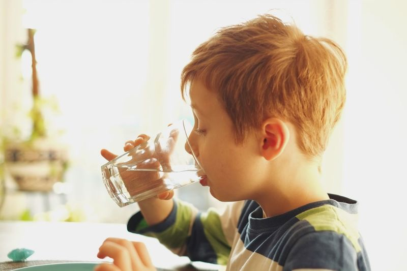 Boy drinking a glass of water. Males  Childhood Child One Boy Only Headshot Children Only Boys Cute One Person Food And Drink Fun Indoors  People Drink Frozen Food Real People Day Close-up Domestic Life Home Interior Lifestyles