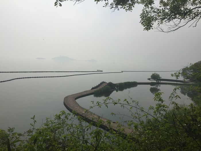 Beauty In Nature Calm Day Distant Lake Majestic Nature No People Non-urban Scene Ocean Outdoors Plant Reflection Remote Scenics Sea Sky Solitude Standing Water Tranquil Scene Tranquility Tree Water Landscape Landscapes China taihu Wuxi 鼋头渚是横卧太湖的一个半岛