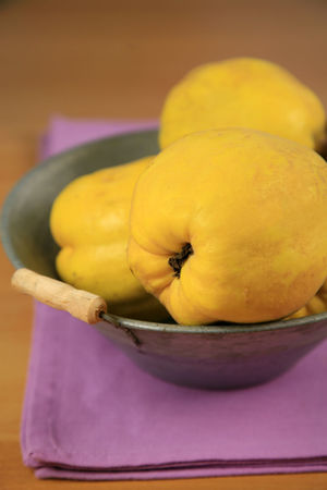 Quince fruits (Cydonia oblonga) in a metal bowl Cydonia Oblonga Pink Shallow Depth Of Field Vegetarian Food Bowl Close-up Day Food Food And Drink Freshness Fruit Harvest Healthy Eating Indoors  Metal Napkin No People Quince Ripe Table Vegan Yellow