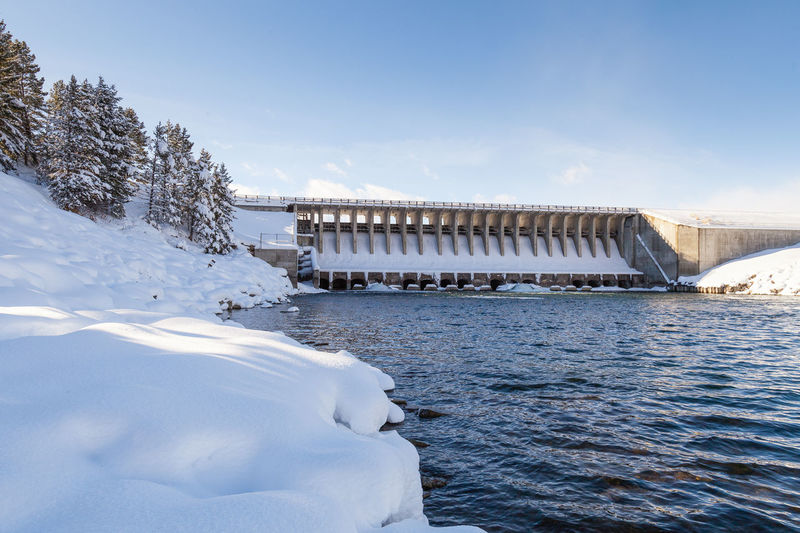 Beauty In Nature Blue Built Structure Cloud Cold Temperature Dam Day Frozen Idyllic Jackson Hole Nature No People Outdoors Season  Sky Snow Weather White White Color Winter
