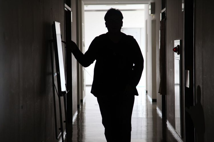 Silhouette Man Standing At Home