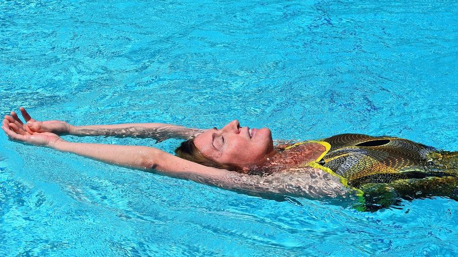 High angle view of swimmer in swimsuit swimming in pool